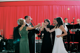 bride-and-groom-toast-parents-at-wedding-reception