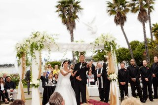 bride-and-groom-under-ceremony-canopy