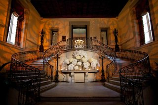 grand-staircase-with-wrought-iron-railing-at-oheka-castle