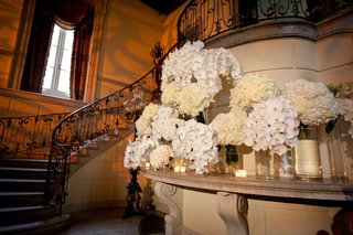 wedding-reception-entry-decorated-with-various-single-variety-arrangements-in-cylinder-vases