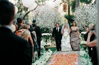 bride-walks-down-rose-petal-aisle-runner-with-parents