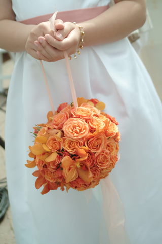 flower-girls-pomander-bouquet-of-orange-and-yellow-flowers