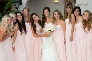 bride-with-bridesmaids-in-pink-chiffon-gowns