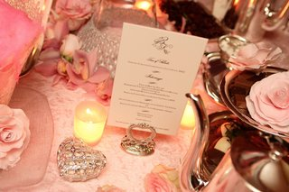 white-and-black-wedding-menu-on-silver-stand