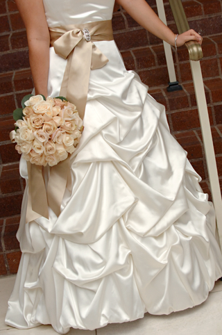 bridal-gown-with-tan-belt-and-flowers