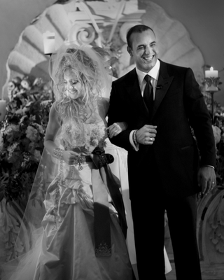black-and-white-image-of-madonna-inspired-bride-with-groom