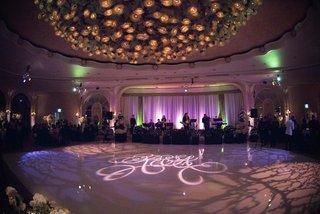 purple-lighting-wedding-reception-with-large-dance-floor