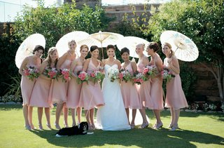 bridesmaids-wear-pink-dresses-and-cary-parasols