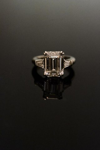 emerald-cut-engagement-ring-with-side-stones
