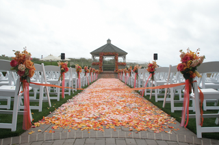 outdoor-wedding-ceremony-decorated-with-pink-orange-and-yellow-flowers