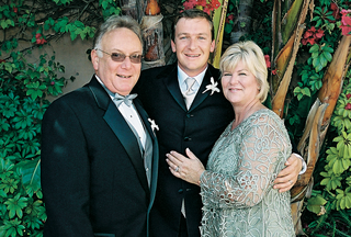 the-groom-with-his-parents-outside