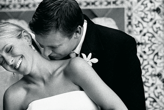 black-and-white-photo-of-groom-kissing-brides-neck