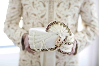 grooms-white-turban-decorated-with-red-and-gold-stones-for-an-indian-hindu-wedding