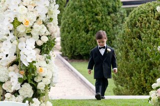 ring-bearer-in-a-black-tuxedo-and-bow-tie