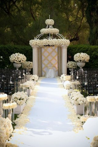 cream-and-white-roses-decorate-aisle-and-canopy
