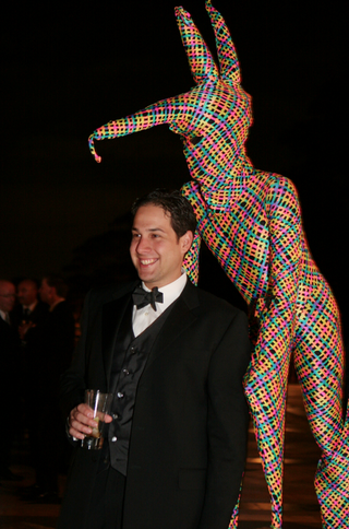man-on-stilts-in-bright-costume-surprises-wedding-guests