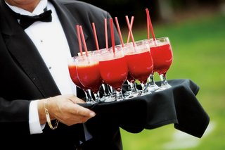 tuxedo-clad-caterer-carrying-platter-of-drinks