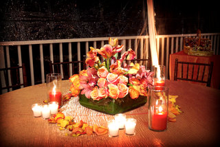 flower-arrangement-with-red-orange-candles