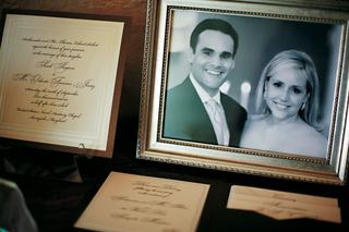 framed-photo-of-newlyweds-alongside-invitations