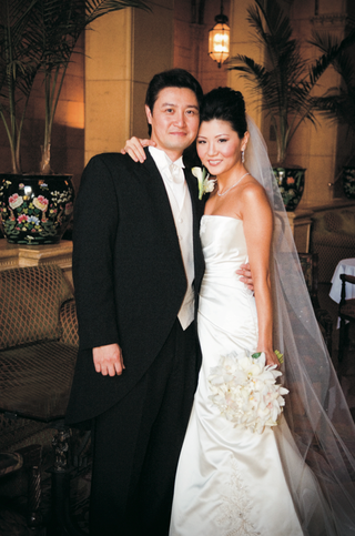 bride-wearing-a-strapless-vera-wang-gown-and-veil-with-groom-in-black-tails