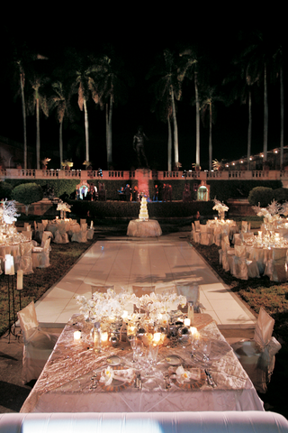 outdoor-evening-reception-with-white-dance-floor-and-ivory-tables