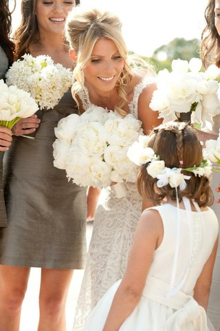 bride-leaning-down-to-talk-to-cute-young-girl