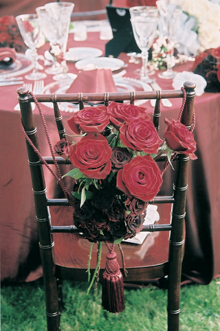 cluster-of-red-roses-attached-to-back-of-chair