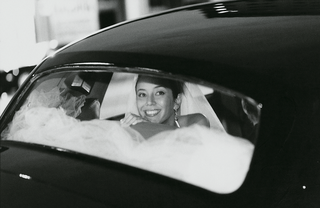 black-and-white-photo-of-bride-in-black-automobile