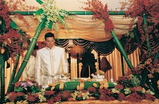 groom-stands-at-altar-of-traditional-cambodia-ceremony