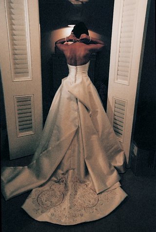 back-of-brides-satin-wedding-dress-with-gold-details