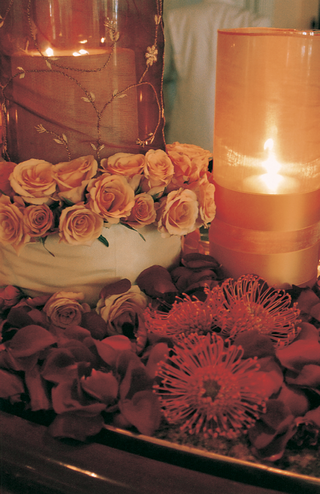 red-rose-petals-and-golden-candles