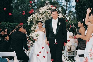 guests-toss-rose-petals-at-couple-after-outdoor-ceremony