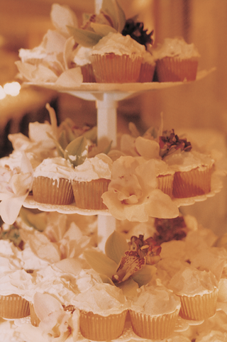 three-tiered-white-cake-stand-with-cupcakes