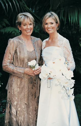 bride-and-her-mom-in-front-of-palm-frond