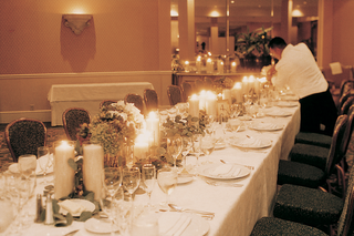 long-rectangular-table-decorated-with-white-and-green-decorations