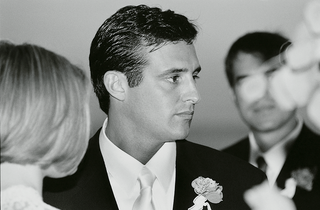 black-and-white-photo-of-groom-at-wedding-ceremony