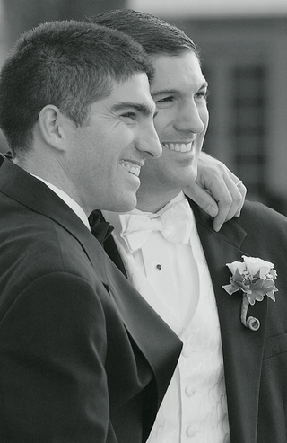 black-and-white-photo-of-groom-and-groomsman