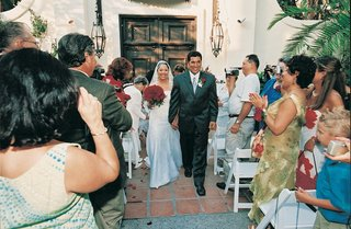 bride-and-groom-exit-wedding-as-newlyweds