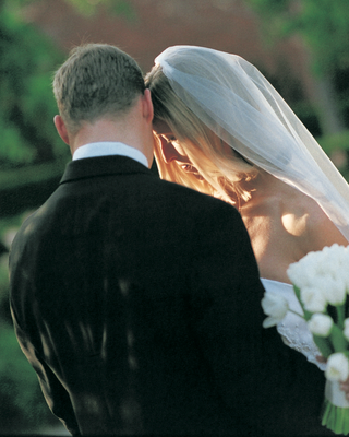 grooms-black-suit-and-brides-white-veil
