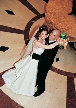white-bridal-gown-and-black-tuxedo