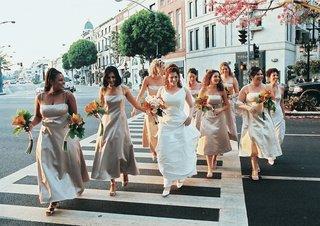 neutral-bridesmaid-dresses-and-orange-flowers