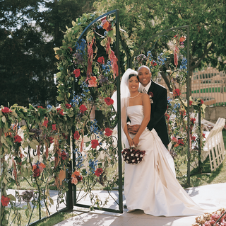 entrance-to-ceremony-through-floral-gate