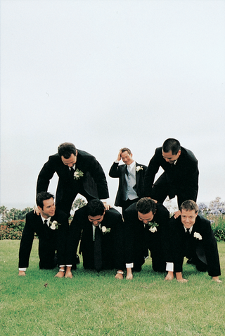groom-and-groomsmen-set-up-a-human-pyramid