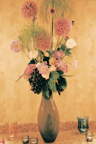 tall-flower-centerpiece-with-grapes-and-pink-flowers