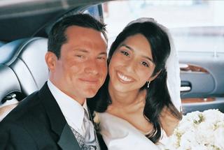bride-and-groom-smile-inside-wedding-transportation