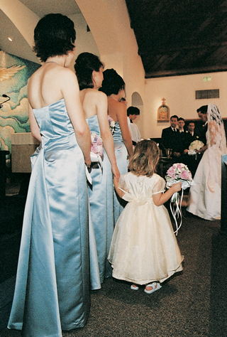 bridesmaids-at-ceremony-wearing-long-light-blue-gowns