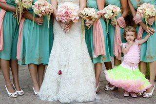 bottom-half-of-bridesmaids-with-flower-girl-in-festive-dress