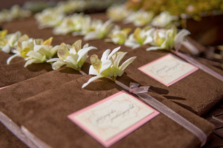 brown-suede-program-covers-with-pink-ribbon-and-white-flower