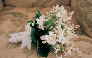 white-and-ivory-flowers-tied-with-ribbon