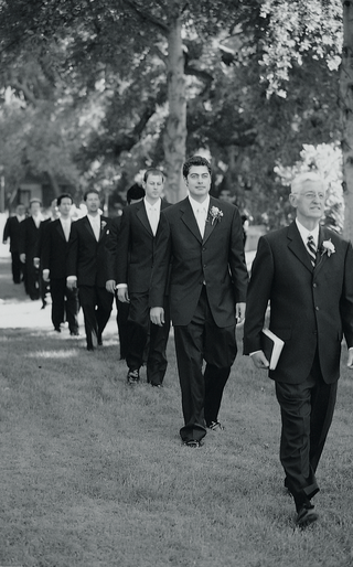black-and-white-photo-of-men-processional